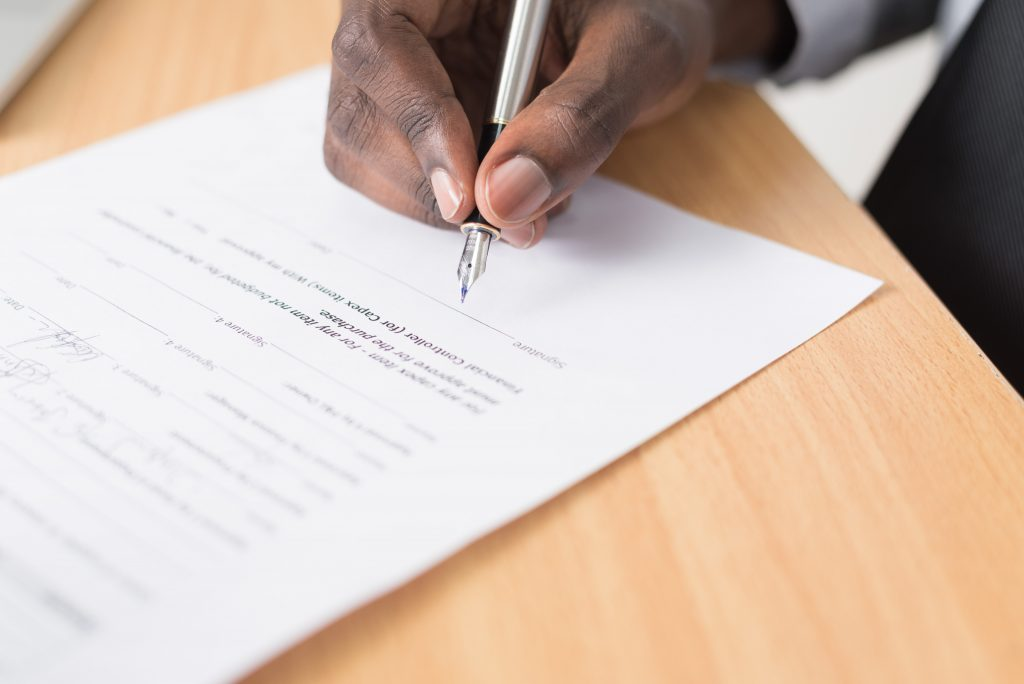 person signing contract document  - cytonn photography GJao3ZTX9gU unsplash 1024x684 - 5 First-Time Homebuyer Mistakes